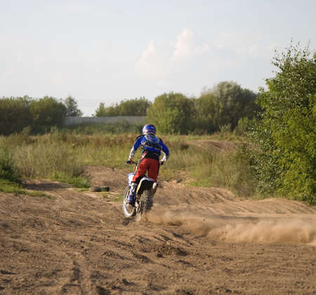 Motorcyclist in action. Ready for jump. Stock Photo