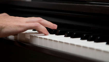I music maker! Closeup photo of piano player mans handle. Stock Photo