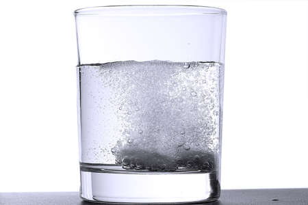 Two effervescent tablets in glass