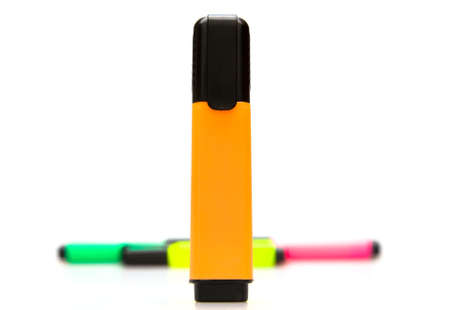 Some colorful marker on  white background. Front focus.