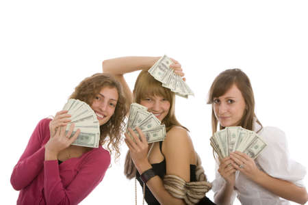 Happy three young girl with dollars in hand