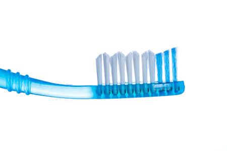 Uno spazzolino da denti su sfondo bianco studio isolato Archivio Fotografico
