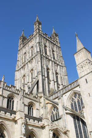 indivisible: View of the tower of Gloucester Cathedral  more formally known as the Cathedral Church of St Peter and the Holy and Indivisible Trinity  in the city of Gloucester Stock Photo