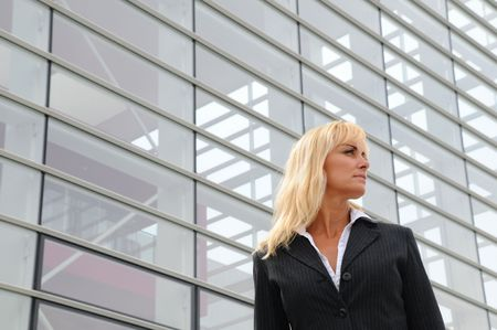 Business woman standing in front of office building. photo