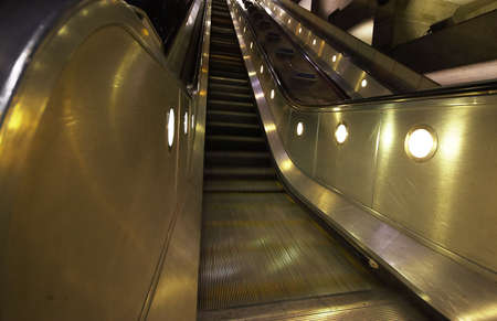 The modern escalators of Westminster underground station in London, England