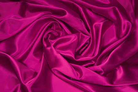 Luxurious deep pink satinsilk folded fabric, useful for backgrounds