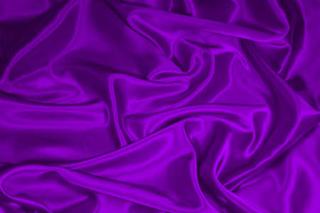Luxurious deep purple satinsilk folded fabric, useful for backgrounds