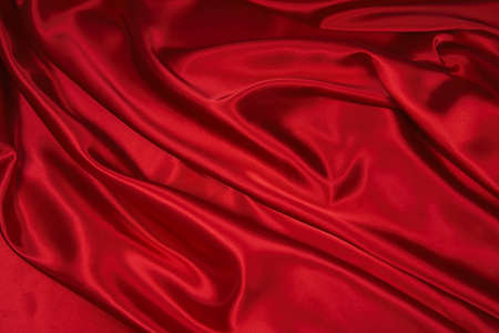 Luxurious deep red satin/silk folded fabric, useful for backgrounds Stock Photo - 485822