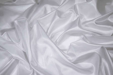Luxurious white satinsilk folded fabric, useful for backgrounds