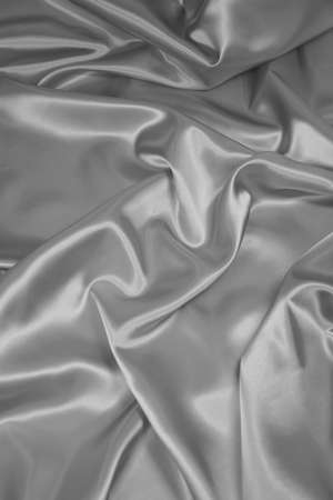 Luxurious silver satin/silk folded fabric, useful for backgrounds Stock Photo - 485817