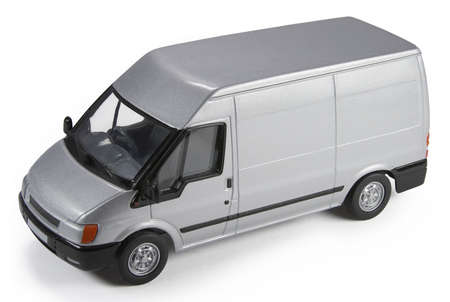 Die-cast toy model of a commercial van isolated on white background with shadow. Useful for mocking up vehicle graphics onto, adding a company logo on the side, etc.