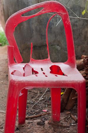 broken chair: Broken red chair.