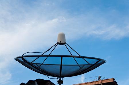 sattelite: Black sattelite dish and blue sky. Stock Photo