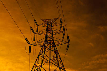 electricity pole: Electricity pole in sunset.Silhouette style. Stock Photo