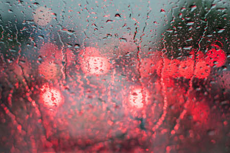 condensacion: Water drop on windshield of car in rainy season,traffic  jam.(Soft focus.)