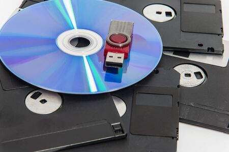 usb drive: Red usb drive put on cd and have disket under them.(Selective focus.)