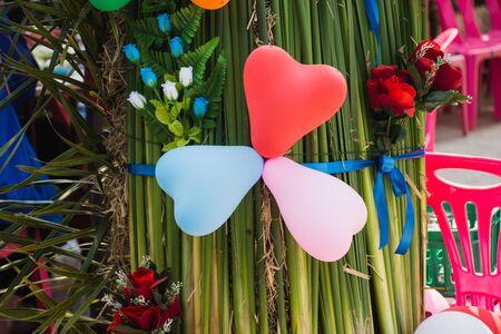 Heart shape balloon on green leaves,soft focus.