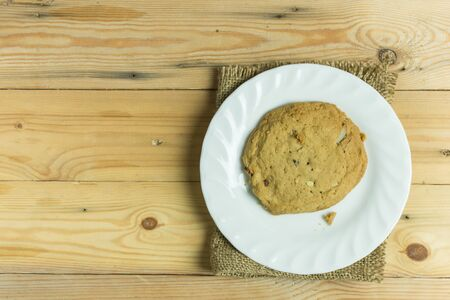 Cookie in dish on wooden table,selective focus.