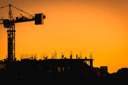 Construction site with people,silhouette style and far shoot.