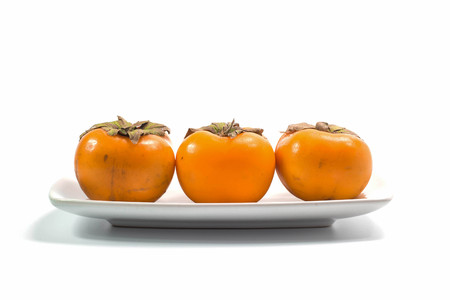tacky: Persimmon fruit on white background