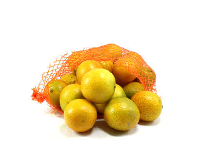 reticle: orange fruit wrapped in plastic reticle on white background