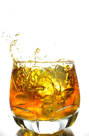splash background: whiskey splashing in glass