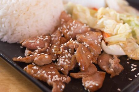 korean salad: Korean style black pepper pork steak served with vegetable salad and rice, selective focus Stock Photo