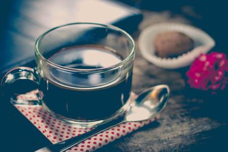 breakfast food: Cup of coffee and breakfast food on old wooden.Simple workspace or coffee break selective focusImage Style vintage Stock Photo
