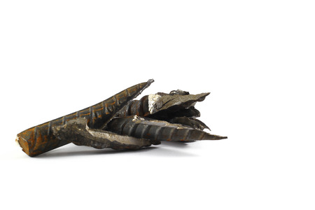 wry: Scrap metal spikes on white background.