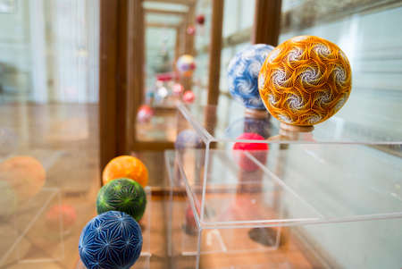 diversified: Temari balls are a folk art form that originated in China and was introduced to Japan around the 7th century A.D. Temari means hand ball in Japanese. Embroidered balls may be used in handball games.