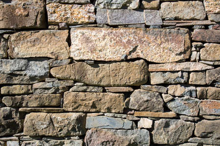 Masonry stone wall of an old house. photo