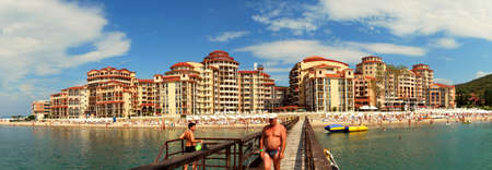Sunny beach, Bulgaria - June 13, 2011: A man is walking on a quay at the bay of Sunny beach in Bulgaria.