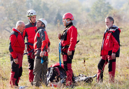 rescue service: Sofia, Bulgaria - November 6, 2014: Rescuers from Mountain Rescue Service at Bulgarian Red Cross are participating in a training cource which took place at Vitosha mountain near Sofia. The course utilizes techniques for rescuing people from a cabin of a s
