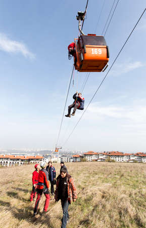 Sofia, Bulgaria - November 6, 2014: Rescuers from Mountain Rescue Service at Bulgarian Red Cross are participating in a training cource which took place at Vitosha mountain near Sofia. The course utilizes techniques for rescuing people from a cabin of a s