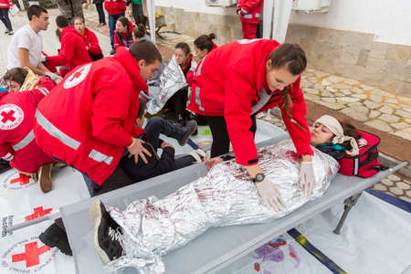 '5 december': Sofia, Bulgaria - December 5, 2014: Members from Bulgarian Red Cross Youth (BRCY) voluntary youth organization are participating in a training simulation of a natural disaster situation.