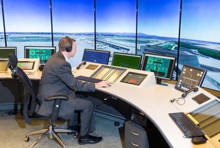 traffic control: Sofia, Bulgaria - December 2, 2014: Air Traffic Controller at the Bulgarian Air Traffic Services Authority (BULATSA) control center are operating on their work places.