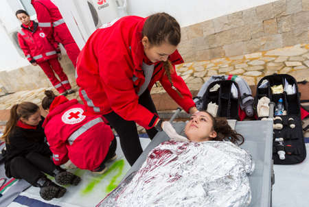 Sofia, Bulgaria - December 5, 2014: Members from Bulgarian Red Cross Youth (BRCY) voluntary youth organization are participating in a training simulation of a natural disaster situation. 免版税图像 - 34361316