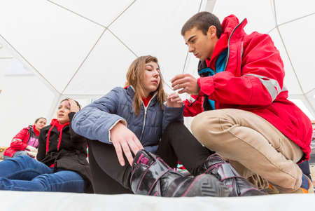 red cross: Sofia, Bulgaria - December 5, 2014: Members from Bulgarian Red Cross Youth (BRCY) voluntary youth organization are participating in a training simulation of a natural disaster situation.