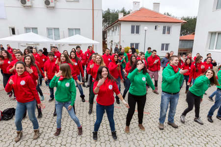 Sofia, Bulgaria - December 5, 2014: Members from Bulgarian Red Cross Youth (BRCY) voluntary youth organization are doing exercises before participating in a training simulation of a natural disaster situation.