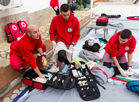 voluntary: Sofia, Bulgaria - December 5, 2014: Members from Bulgarian Red Cross Youth (BRCY) voluntary youth organization are participating in a training simulation of a natural disaster situation.