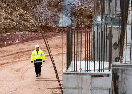 Sofia, Bulgaria - November 24, 2014: An engineer is walking at a construction site of a new waste plant near Sofia.