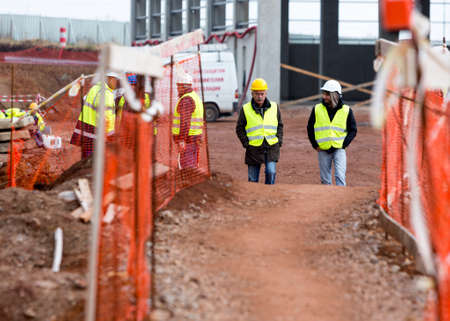 Sofia, Bulgaria - November 24, 2014: Engineers are walking at a construction site of a new waste plant near Sofia.