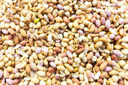 pistachios: Mixture of different nuts. Peanuts, almonds, cashews, pistachios. Stock Photo
