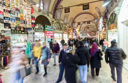 eminonu: Istanbul, Turkey - November 15, 2014: People walking through the shops of the Egyptian Bazaar in Istanbul, the biggest covered market of Turkey. Editorial