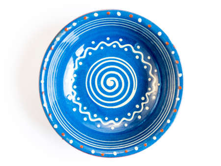 bulgarian: Traditional blue Bulgarian painted ceramic dish isolated on white.