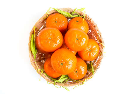 bisected: Tangerine in a basket from above isolated on a white background. Stock Photo