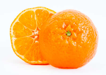 bisected: Single tangerine sliced isolated on a white background.