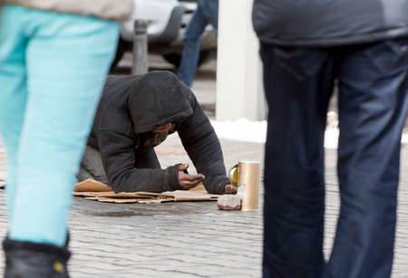 begging: A homeless begger is begging on a busy street in the center of Sofia.