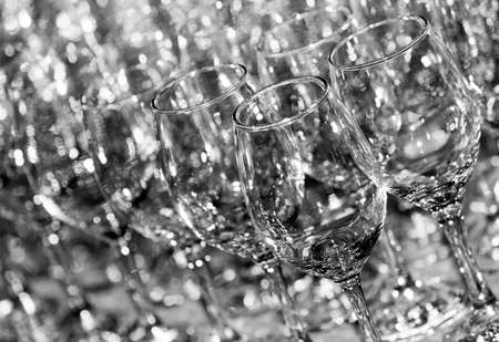 whine: Many empty black and white glasses for water or whine