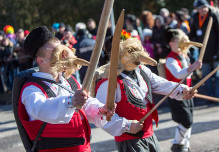 participants: Participants are participating in the International Festival of Masquerade Games Surva. The festival promotes variations of ancient Bulgarian and foreign customs and masks that are still alive today.